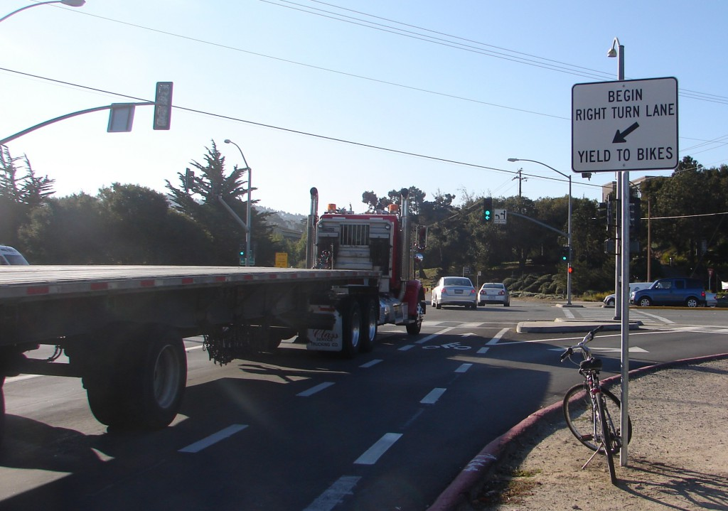 SIGN - by big truck) Camino Aguajito yield to bikes (2)
