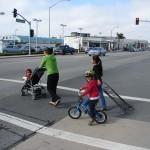 Seaside - young biker with moms in crosswalk