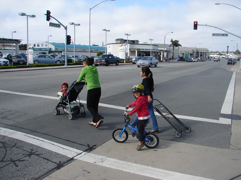 Seaside - young biker with moms in crosswalk