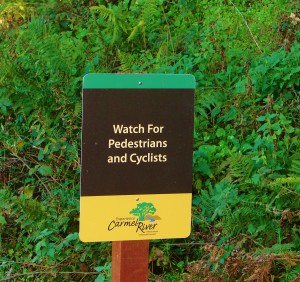 Experience Carmel River sign - watch for cyclists and peds
