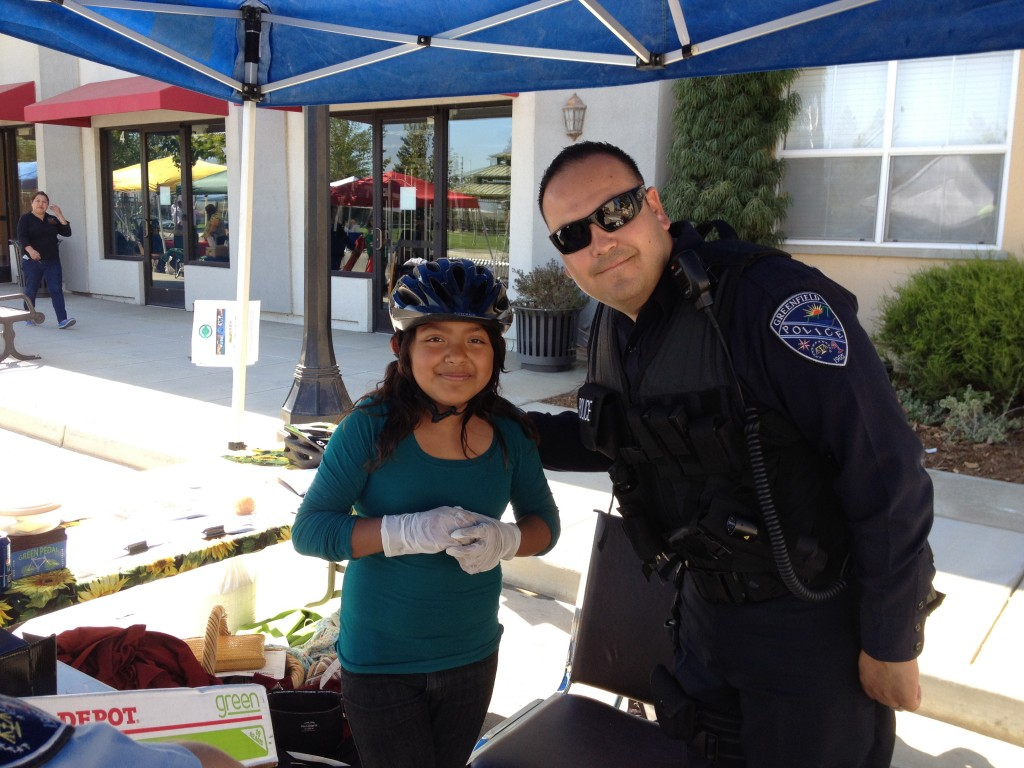 Girl fitted for helmet by Greenfield PD 2012